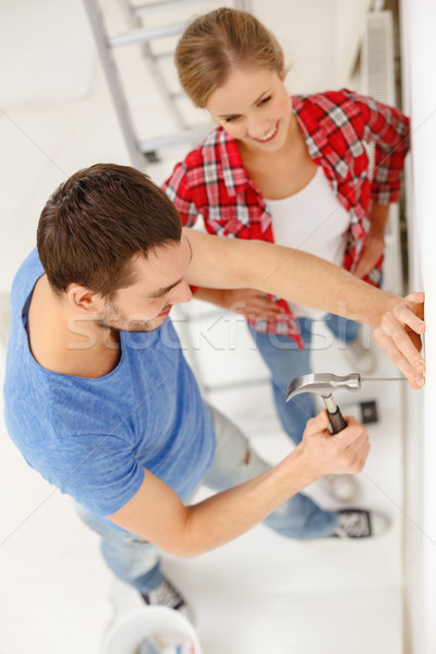 smiling couple renovating new home Stock photo © dolgachov