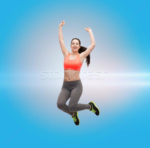 Sportlich springen Sportbekleidung Fitness Ernährung Stock foto © dolgachov