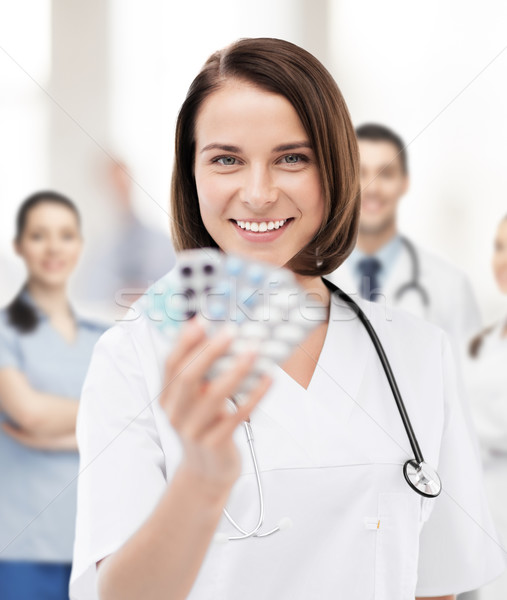 doctor with blister packs of pills Stock photo © dolgachov