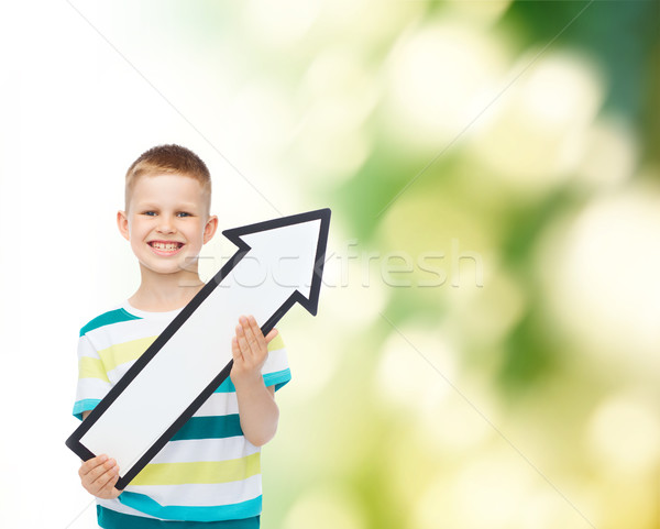 smiling little boy with blank arrow pointing right Stock photo © dolgachov