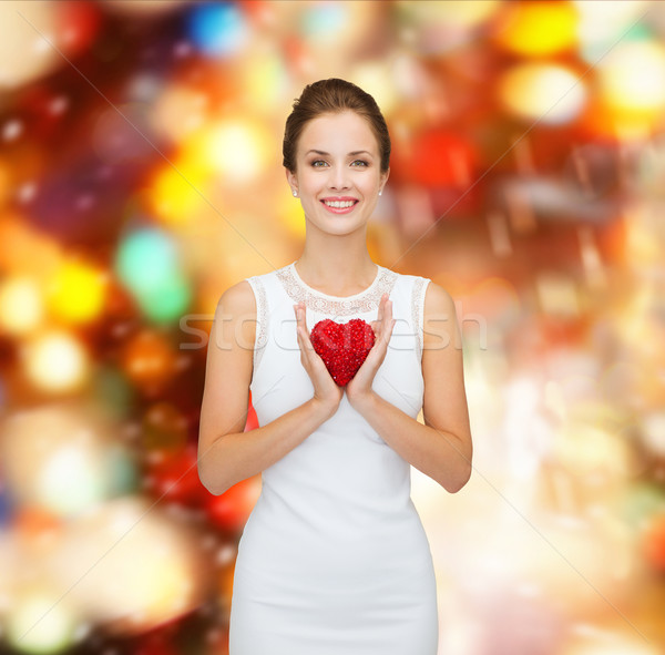 smiling woman in white dress with red heart Stock photo © dolgachov