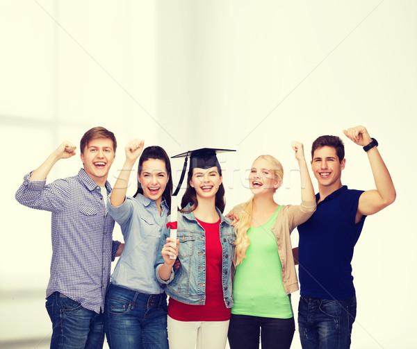 Grupo pie sonriendo estudiantes diploma educación Foto stock © dolgachov
