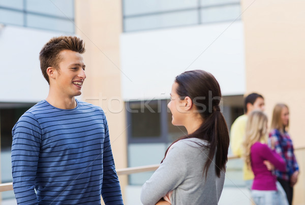 group of smiling students outdoors Stock photo © dolgachov