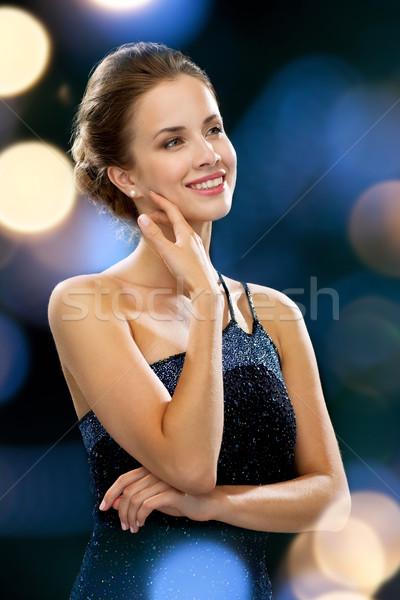 улыбающаяся женщина вечернее платье люди праздников гламур ночь Сток-фото © dolgachov