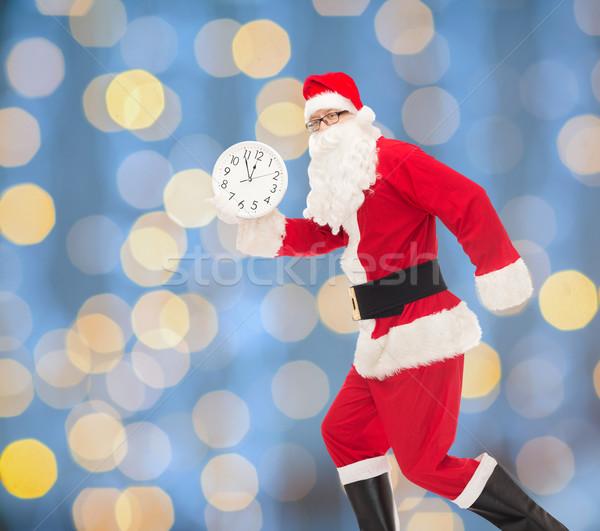 Férfi jelmez mikulás óra karácsony ünnepek Stock fotó © dolgachov