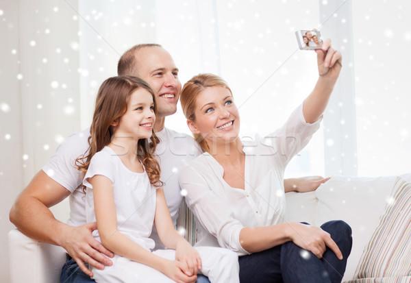 счастливая семья камеры фотография домой дома Сток-фото © dolgachov