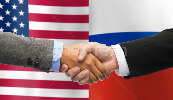 handshake over american and russian flags Stock photo © dolgachov