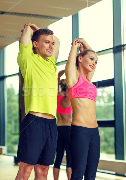 Souriant homme femme gymnase sport Photo stock © dolgachov