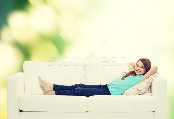 smiling little girl lying on sofa Stock photo © dolgachov