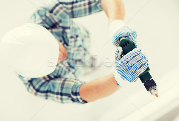 Stock photo: man drilling the wall