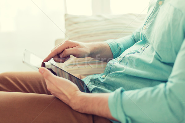 close up of man with tablet pc computer at home Stock photo © dolgachov