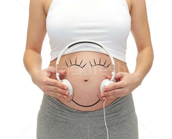 Mujer embarazada auriculares embarazo personas Foto stock © dolgachov