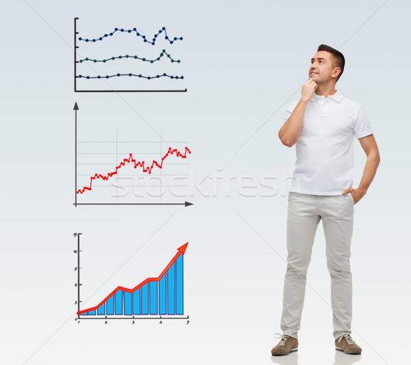 Mosolyog férfi kezek felfelé néz üzlet statisztika Stock fotó © dolgachov