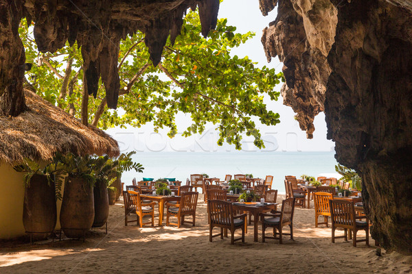 view to open-air restaurant on beach from cave Stock photo © dolgachov