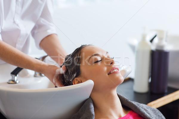 happy young woman at hair salon Stock photo © dolgachov