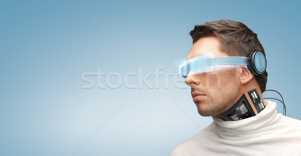 man with futuristic glasses and sensors Stock photo © dolgachov