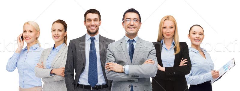 Grupo sorridente empresários pessoas de negócios gesto escritório Foto stock © dolgachov