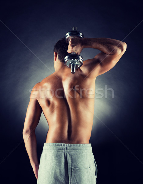 young man with dumbbell Stock photo © dolgachov