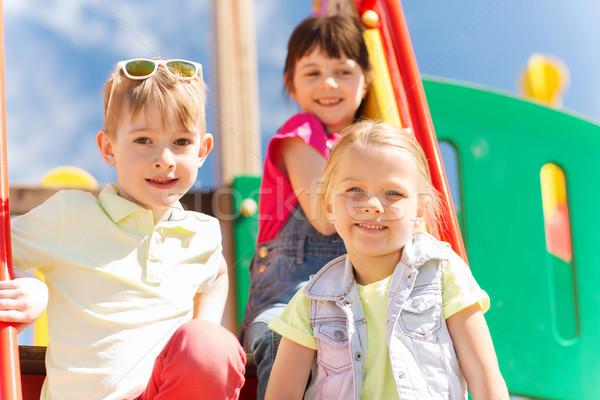 Csoport boldog gyerekek gyerekek játszótér nyár Stock fotó © dolgachov