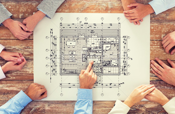 close up of business group with blueprint Stock photo © dolgachov