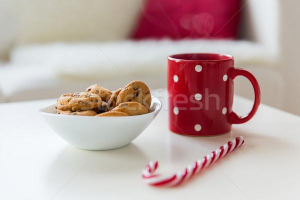Közelkép zab sütik cukornád cukorka csésze Stock fotó © dolgachov