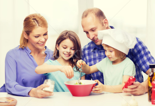 happy family with two kids eating at home Stock photo © dolgachov