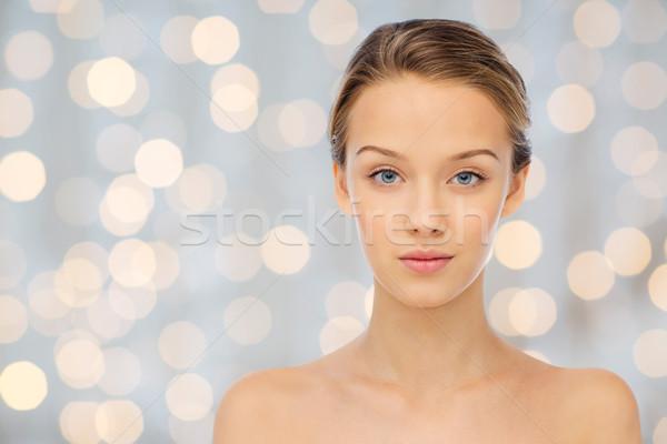 Mulher jovem cara nu ombros luzes beleza Foto stock © dolgachov