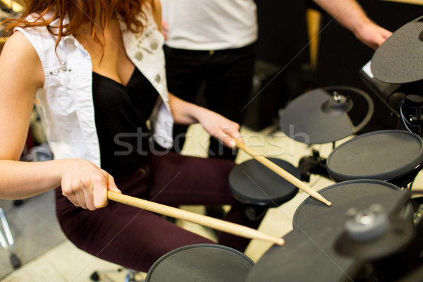 close up of man and woman playing on drum kit Stock photo © dolgachov