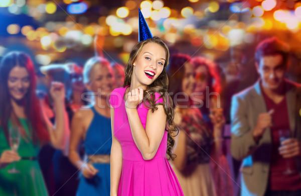 Heureux femme Teen fête cap night-club Photo stock © dolgachov