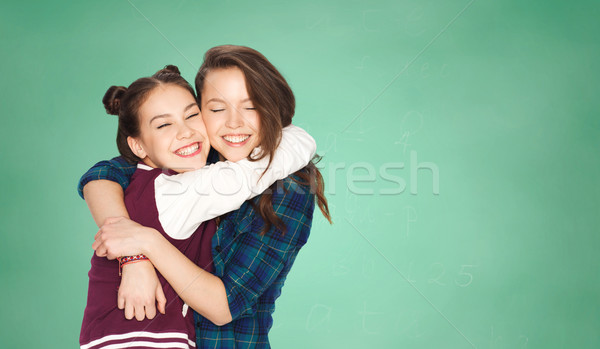 Boldog tinilányok ölel zöld tábla emberek Stock fotó © dolgachov
