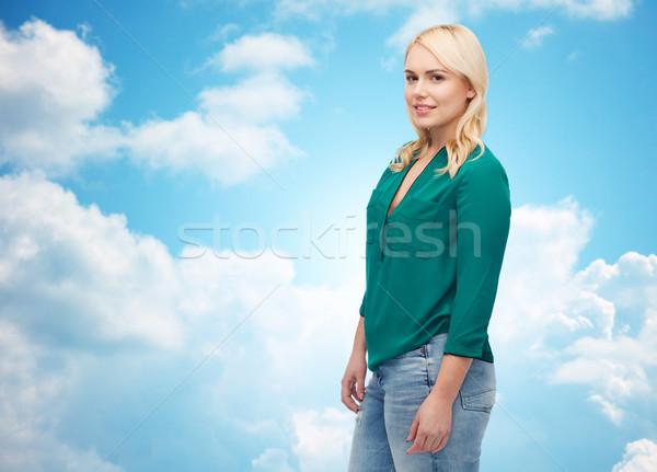 Gülen genç kadın gömlek kot kadın cinsiyet Stok fotoğraf © dolgachov