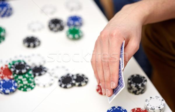 Maschio mano carte da gioco chip tempo libero Foto d'archivio © dolgachov