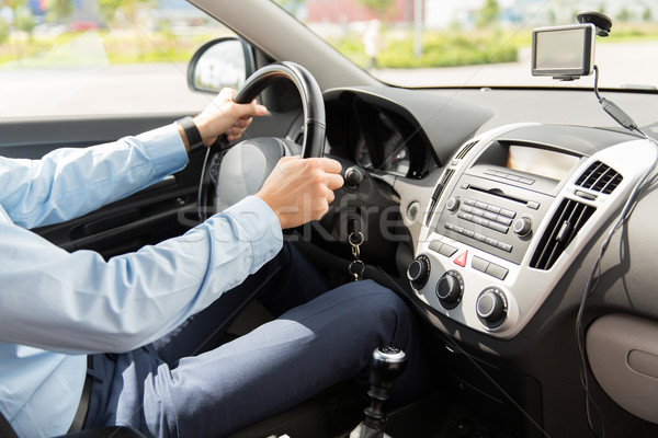 close up of young man driving car Stock photo © dolgachov