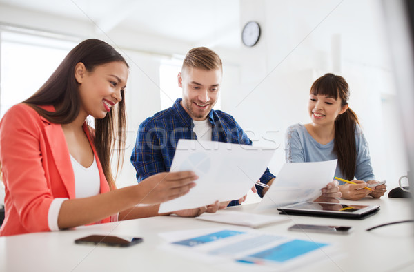 happy creative team or students working at office Stock photo © dolgachov