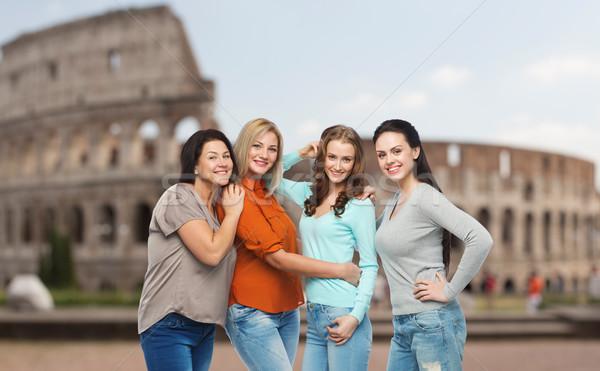 group of happy different women over coliseum Stock photo © dolgachov