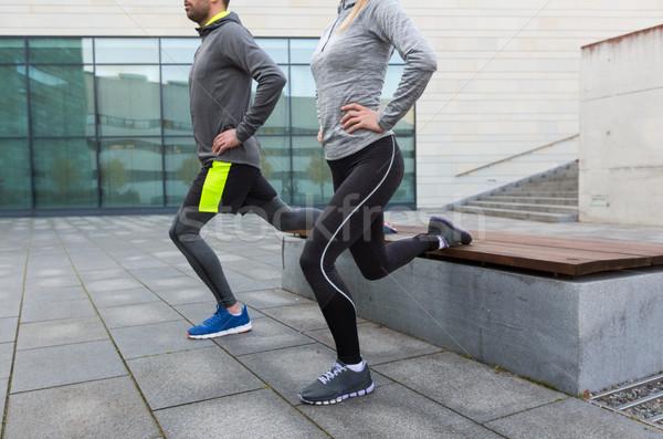 close up of couple doing lunge exercise on street Stock photo © dolgachov