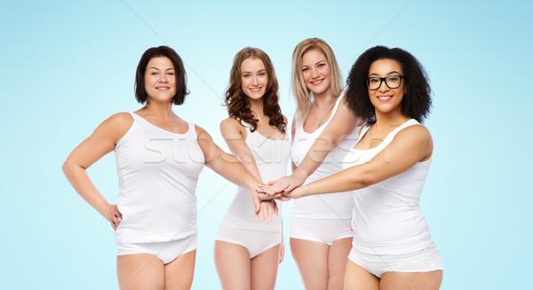 ストックフォト: グループ · 幸せ · 異なる · 女性 · 手 · 先頭