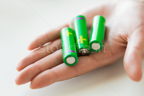 close up of hand holding green alkaline batteries Stock photo © dolgachov