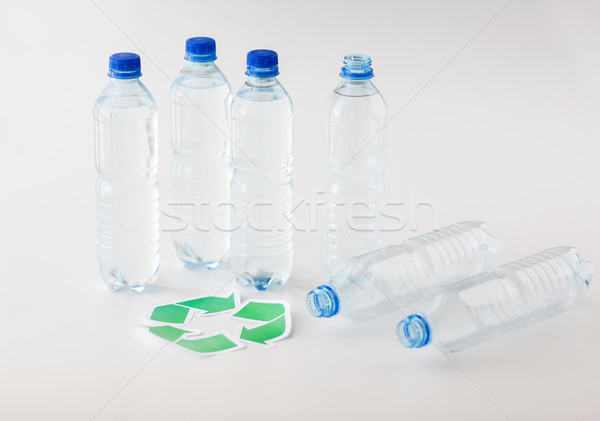 close up of plastic bottles and recycling symbol Stock photo © dolgachov