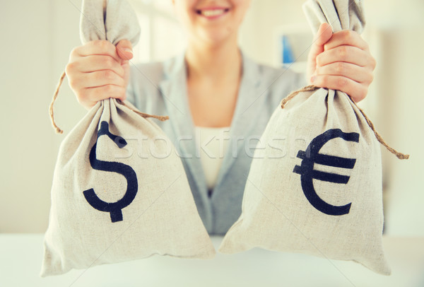 close up of woman hands holding money bags Stock photo © dolgachov