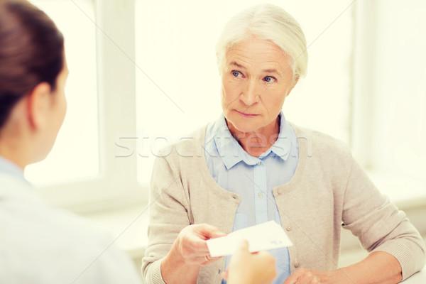 Lekarza recepta starszy kobieta muzyka wiek Zdjęcia stock © dolgachov