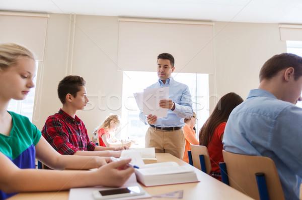 Stok fotoğraf: Grup · Öğrenciler · öğretmen · test · sonuçları · eğitim · okul