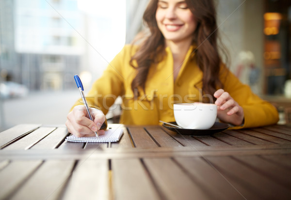 happy woman with notebook and cappucino at cafe Stock photo © dolgachov