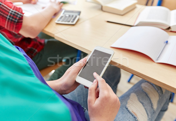 student girl with smartphone texting at school Stock photo © dolgachov
