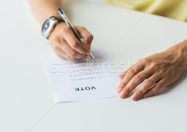 close up of hands with vote or ballot on election Stock photo © dolgachov