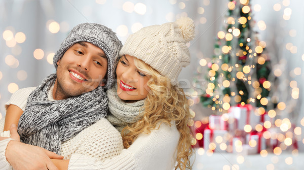 happy family couple in winter clothes hugging Stock photo © dolgachov