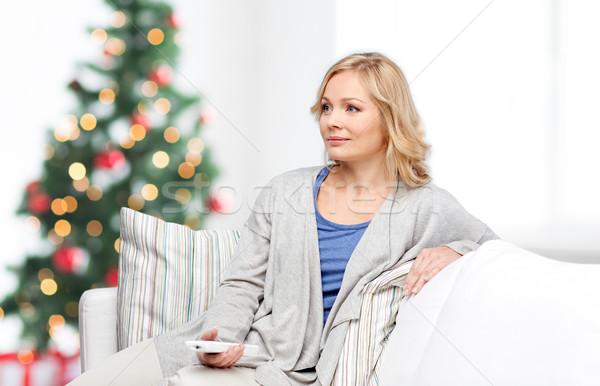улыбающаяся женщина контроль Рождества телевидение праздников Сток-фото © dolgachov