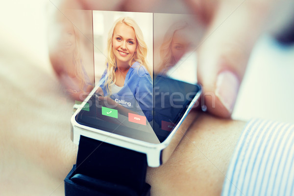close up of hand with incoming call on smart watch Stock photo © dolgachov