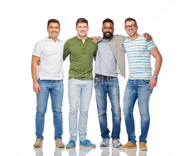 international group of happy smiling men Stock photo © dolgachov