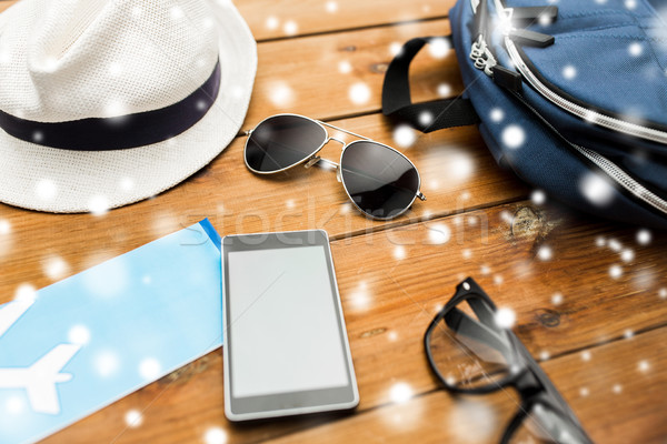smartphone, airplane ticket and personal stuff Stock photo © dolgachov